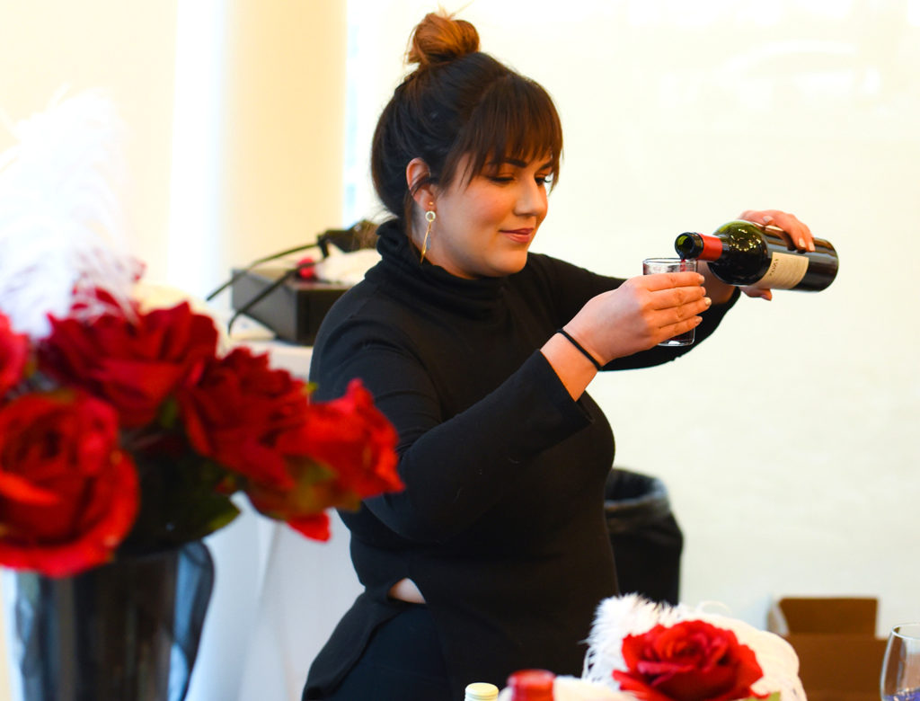 "Photo of Sara Jo Mathews from Borracho's Craft Booze and Brews pouring wine for attendees at last year's ""Love and War"" chocolate event."